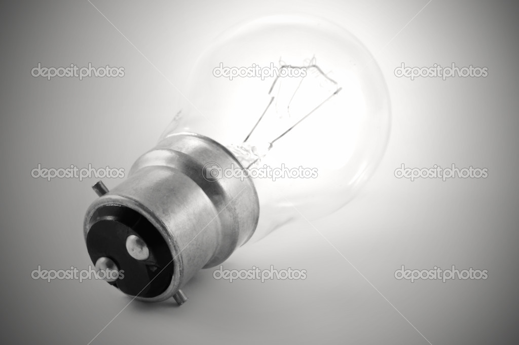 Close up of a single illuminated light bulb with grey background  Stock Photo #5232107