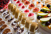 Miniature decorative desserts — Stock Photo