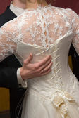 Bride a cord on a dress — Stock Photo