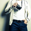 Guy holding the film camera — Stock Photo