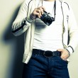Guy holding the film camera - Stock Photo