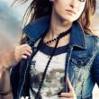 Young woman in jeans jacket - Stock Photo