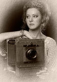 Young woman near the old camera — Stock Photo