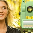 Girl and Total Station — Stock Photo #4988012