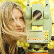Stock Photo: Girl and Total Station