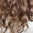 Brown curly hair — Stock Photo