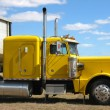 Yellow truck against blue sky - Zdjęcie stockowe