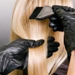 Hairdresser doing hair dye — Stock Photo