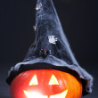 Halloween orange pumpkin with witch hat - Stock Photo