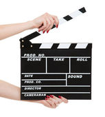 Cinema clapboard in female hands — Stock Photo