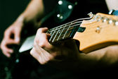 Man hands on guitar — Stock Photo
