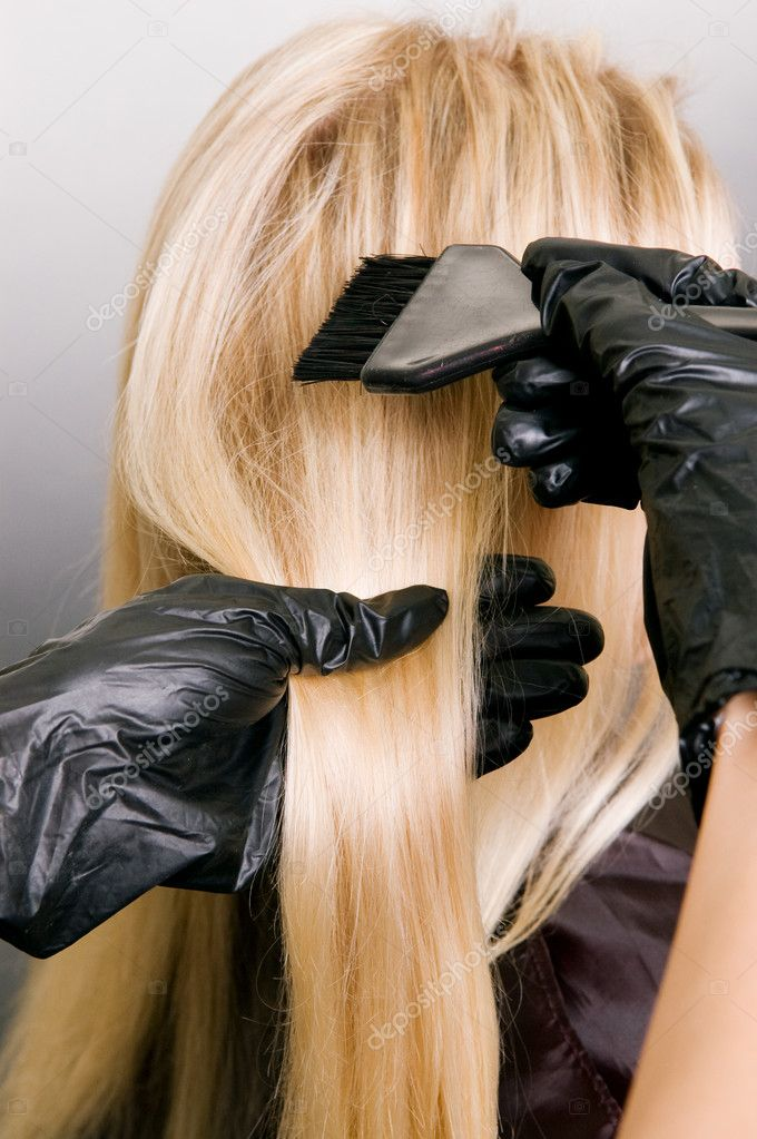 Hairdresser doing hair dye. photo against grey background — Stock Photo #5099515