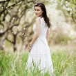 Beautiful young woman in white dress — Stock Photo