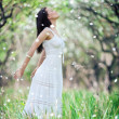 Carefree young woman in white dress — Stock Photo #5156783