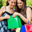 Smiley friends with bags — Stock Photo