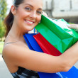 Stock Photo: Happy womwith her purchases