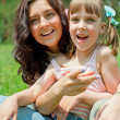 Happy mother with daughter - Stock Photo