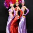 Foto Stock: Beautiful trio in stage costumes