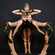 Three dancers in military uniform posing — Stock Photo