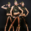 Three dancers in military uniform — Stock Photo