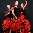 Three dancers in spanish dresses — Stock Photo