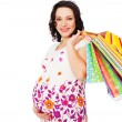Pregnant woman holding shopping bags - ストック写真