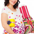 Pregnant woman with gift boxes — Stock Photo