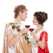 Couple in greek style with wine — Stock Photo