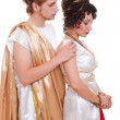 Sad couple in Greek style - Stock Photo