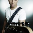 Portrait of young man with guitar — Stock Photo