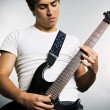 Young mplaying on guitar — Stock Photo #5157554