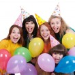Stock Photo: Happy girls with variegated balloons