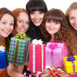 Smiley women with motley gift boxes — Stock Photo