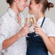 Beautiful smiley couple with champagne — Stock Photo