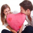 Cheerful couple with pink heart — Stock Photo
