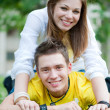 Happy teenagers on the grass — Stock Photo