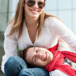 Two teenagers resting at the street — Stock Photo #5158078