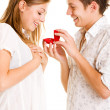 Young man giving his girlfriend ring - Stockfoto