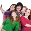 Happy friends taking picture on phone — Stock Photo