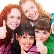 Happy girls showing thumbs up — Stock Photo