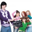 Man with clapboard over women - Stock Photo