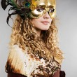 Beautiful blond in venetimask with feathers — Stock Photo #5158274