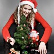 Curly woman with christmas tree and santa — Stock Photo