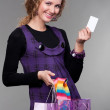 Royalty-Free Stock Photo: Happy woman with credit card and bags