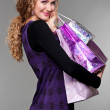 Happy woman with purchases — Stock Photo