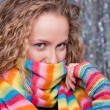 Pretty blonde in bright rainbow scarf - Stock Photo