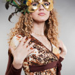 Young woman in venetian mask — Stockfoto