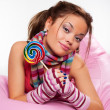 Lively girl with sugarplum — Stockfoto