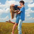 Happy couple on field — Stock Photo