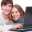 Smiley couple with laptop — Stock Photo
